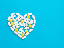 Pills over blue background Royalty Free Stock Photo