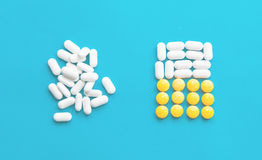 Pills over blue background Stock Photos