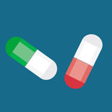 Pills over blue background. Two pills over blue background Stock Photography