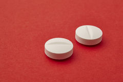 Pills over a red background. Medicament treatment. Health care Royalty Free Stock Photo