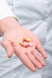 Pills on the palm. Woman with pills on her palm, close-up Royalty Free Stock Photography