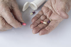 Pills on palm of a senior person Stock Image
