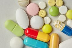 Pills pharmacy collection on paper background. Colorful different size kinds drugs antibiotic macro view.  Stock Images