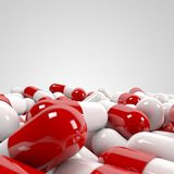 Pills pile. On white background Royalty Free Stock Photography