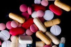 Pills on pile Stock Photo