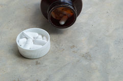 Pills and pill bottle. Close-up Stock Images