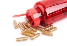 Pills and pill bottle Stock Photos