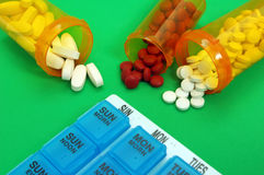 Pills with Pill Organizer Royalty Free Stock Images