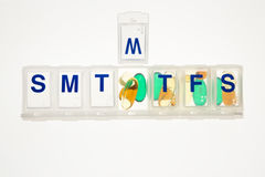 Pills in a Pill Organizer. Isolated Royalty Free Stock Photography