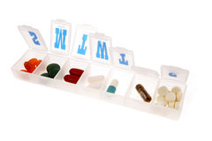 Pills in pillbox on. White stock photography