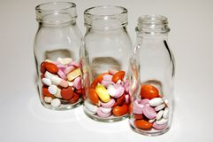 Pills and pills. A bunch of colorful pills from a glass bottle Stock Photo