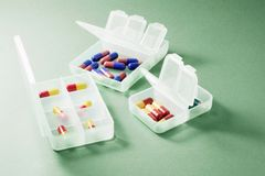 Pills in Plastic Boxes stock images