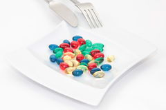Pills on the plate. Separated on white Stock Images
