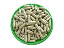 Pills in a plate. On a white background Royalty Free Stock Photos