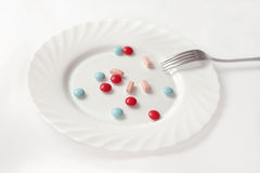 Pills in a plate Stock Photos