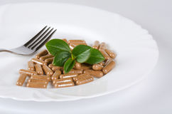 Pills in plate Stock Image