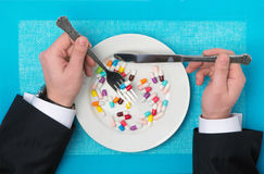 Pills on a plate. On the background Stock Photos