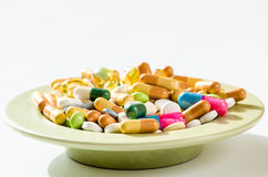 Pills on plate  Royalty Free Stock Image