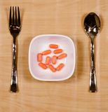 Only pills in the plate - food diet concept.  Royalty Free Stock Images