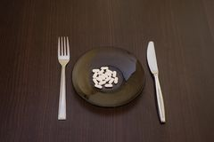 Pills on plate. On the table Royalty Free Stock Image