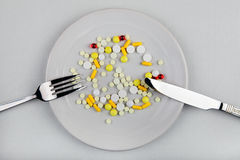 Pills in the Plate. On the Table Royalty Free Stock Photography