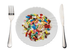 Pills on plate. On a white background Stock Photography