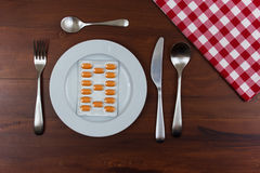 Pills in a plate Royalty Free Stock Photo