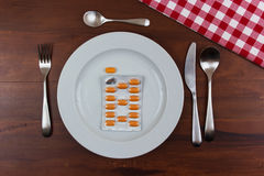 Pills in a plate Stock Photography