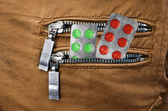 Pills in the pocket of jeans Stock Photo