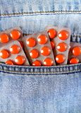 Pills in the Pocket. Many Pills in the Jeans Pocket closeup stock photos