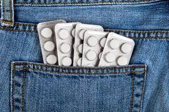 Pills in the Pocket. Many Pills in the Jeans Pocket closeup royalty free stock photography