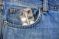 Pills in the Pocket. Pills in the Jeans Pocket closeup royalty free stock photography