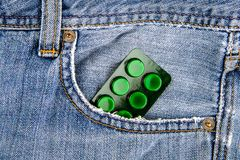 Pills in the Pocket. Pills in the Jeans Pocket closeup royalty free stock images