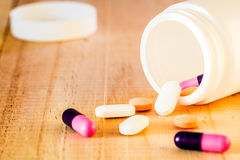Pills from pour medicine bottles Royalty Free Stock Photography