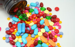 Pills pouring out of the bottle Royalty Free Stock Photo