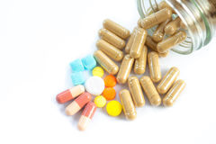 Pills pouring out of the bottle Royalty Free Stock Photos