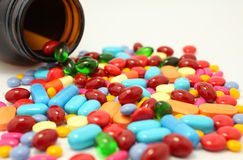 Pills pouring out of the brown bottle Royalty Free Stock Photography