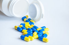 Pills pouring Stock Images