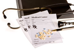 Pills prescription. Little pills and a stethoscope lying on a doctor's prescription Royalty Free Stock Images
