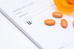 Pills on a prescription pad Royalty Free Stock Image