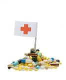 Pills and red cross flag Royalty Free Stock Images