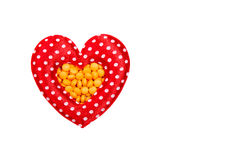 Pills in red heart shaped Royalty Free Stock Photo
