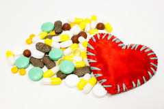 Pills and red Royalty Free Stock Image