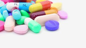 Pills rotation on isolated white stock footage