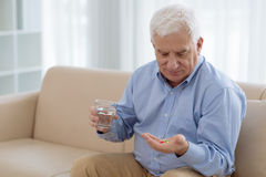 Pills for senior stock photos