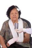 Pills with senior woman injured Royalty Free Stock Image