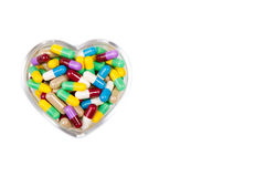 Pills in the shape of  heart Royalty Free Stock Photo