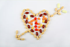 Pills in shape of love heart with arrow Royalty Free Stock Images