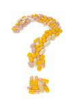 Pills in the shape of a question mark Stock Photography