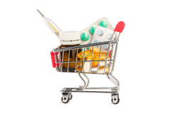 Pills in shopping cart. Drags and pills in shopping cart isolated Stock Images